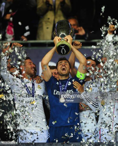 Real Madrid captain Iker Casillas lifts the trophy after the UEFA Super Cup match between Real Madrid and Sevilla FC at Cardiff City Stadium on...
