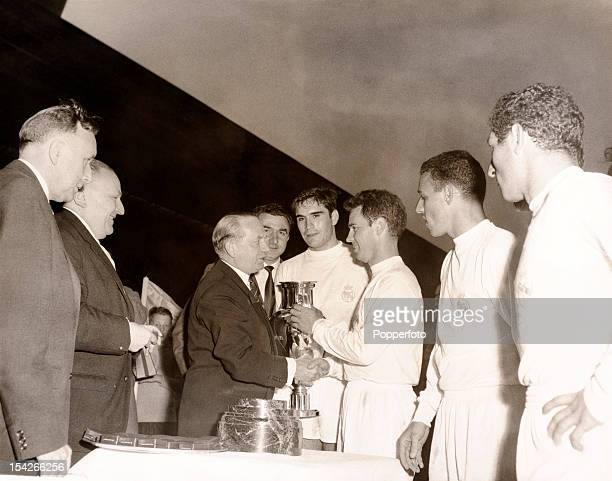 Real Madrid captain Jose Maria Zarraga receives the European Cup from UEFA President Ebbe Schwartz after their 73 victory over Eintracht Frankfurt at...