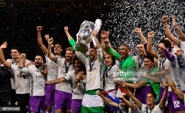 TOPSHOT Real Madrid captain Sergio Ramos lifts the trophy after Real Madrid won the UEFA Champions League final football match between Juventus and...