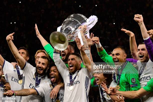 Real Madrid captain Sergio Ramos lifts the trophy after Real Madrid won the UEFA Champions League final football match between Juventus and Real...