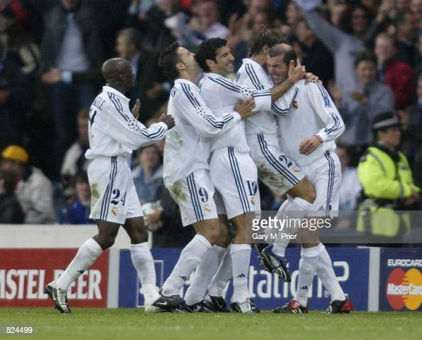 Real Madrid celebrate with Zinedine Zidane after he scored their second goal during the UEFA Champions League Final between Real Madrid and Bayer...