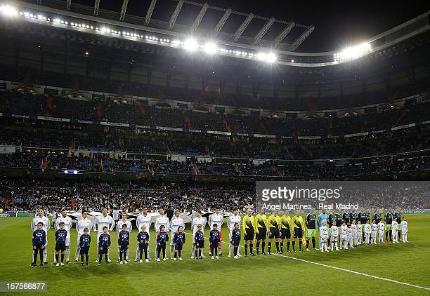 Real Madrid CF and Ajax Amsterdam line up before the UEFA Champions League Group D match between Real Madrid and Ajax Amsterdam at Estadio Santiago...