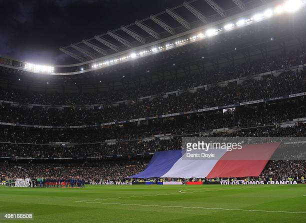 Real Madrid CF and FC Barcelona players hold a minute of silence for the victims of the Paris attacks during the La Liga match between Real Madrid...