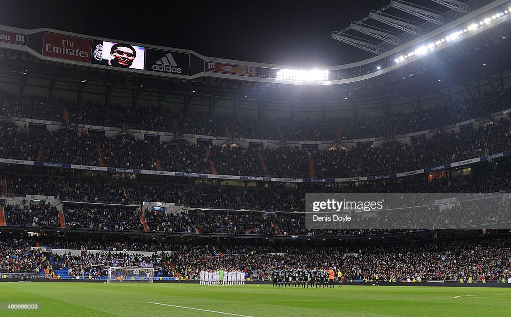 Real Madrid CF (L) and RC Celta de Vigo players hold a minute of silence in memory of the Portuguese player Eusebio prior to the start of the La Liga match between Real Madrid CF and RC Celta de Vigo at the Santiago Bernabeu stadium on January 6, 2014 in Madrid, Spain.