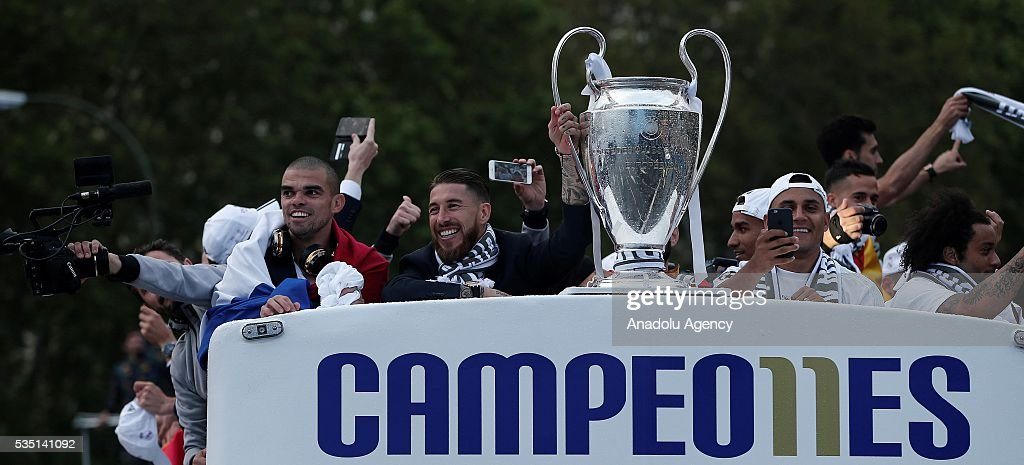 Real Madrid CF footballers hold the trophy in celebration during their team celebration at Cibeles square after winning the UEFA Champions League Final match against Club Atletico de Madrid on May 29, 2016 in Madrid, Spain.