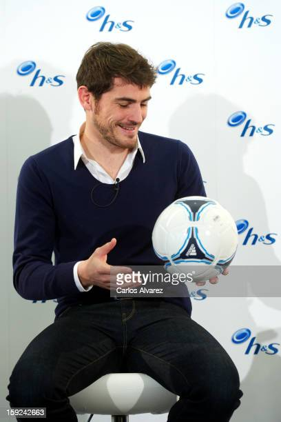 Real Madrid CF goalkeeper Iker Casillas reveals the importance of 'No Distractions' with the help of headshoulders during a photocall at Hotel Puerta...