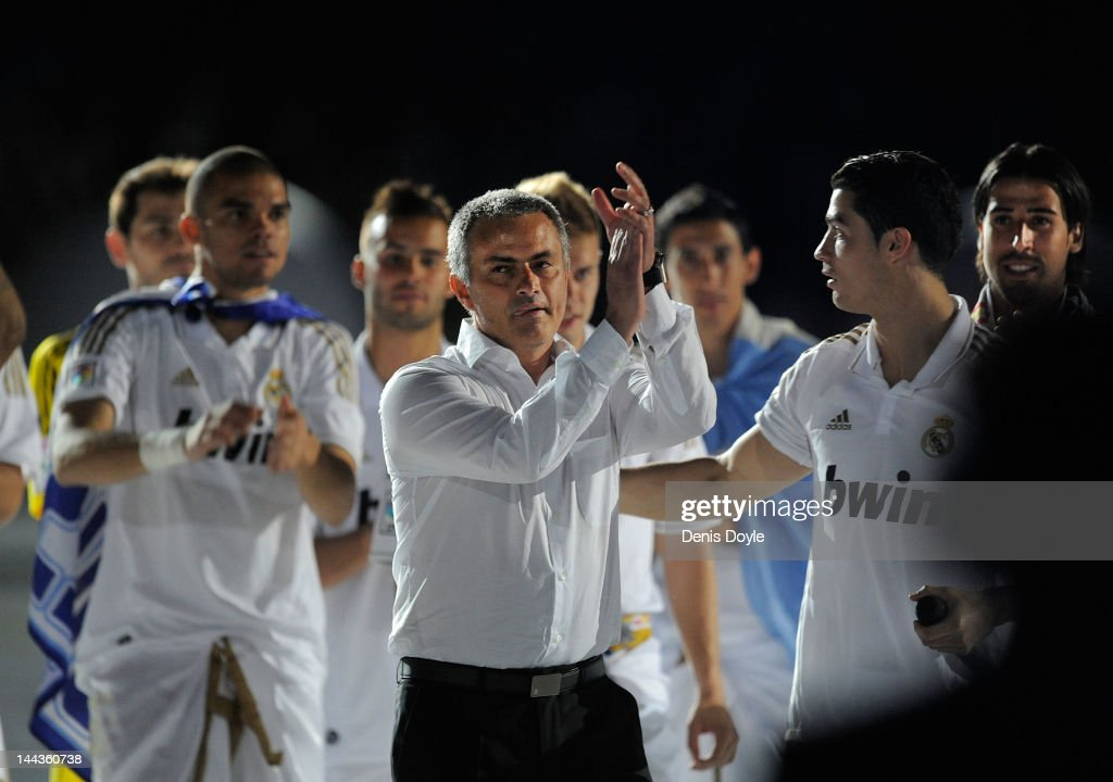 Real Madrid CF head coach Jose Mourinho (C) celebrates the La Liga title with <a gi-track='captionPersonalityLinkClicked' href=/galleries/search?phrase=Cristiano+Ronaldo+-+Soccer+Player&family=editorial&specificpeople=162689 ng-click='$event.stopPropagation()'>Cristiano Ronaldo</a> (R) after the La Liga match between Real Madrid CF and RCD Mallorca at Estadio Santiago Bernabeu on May 13, 2012 in Madrid, Spain.