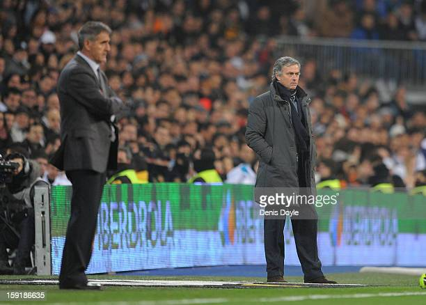 Real Madrid CF head coach Jose Mourinho looks on beside Real Club Celta de Vigo head coach Paco Herrera during the Copa del Rey round of 16 second...