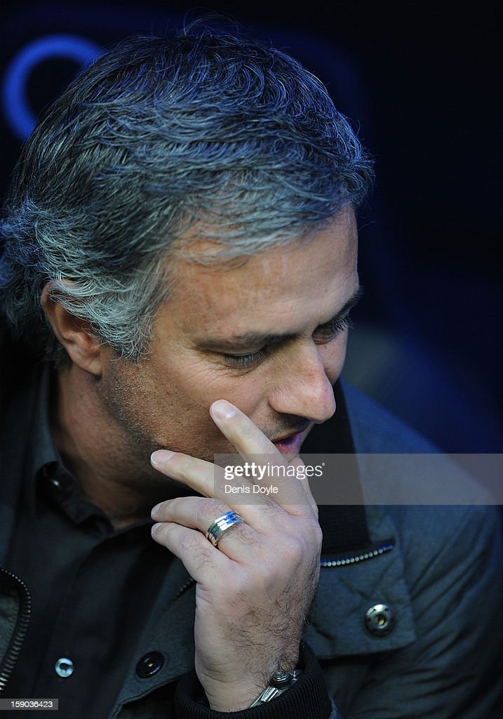 Real Madrid CF head coach Jose Mourinho looks on during the La Liga match between Real Madrid CF and Real Sociedad de Futbol at estadio Santiago Bernabeu on January 6, 2013 in Madrid, Spain.