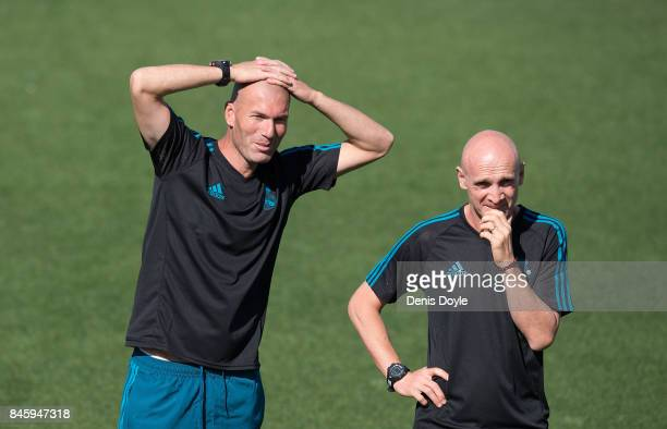 Real Madrid CF manager Zinedine Zidane smiles beside his assistant coach David Bettoni during the Real Madrid CF training session at Valdebebas...