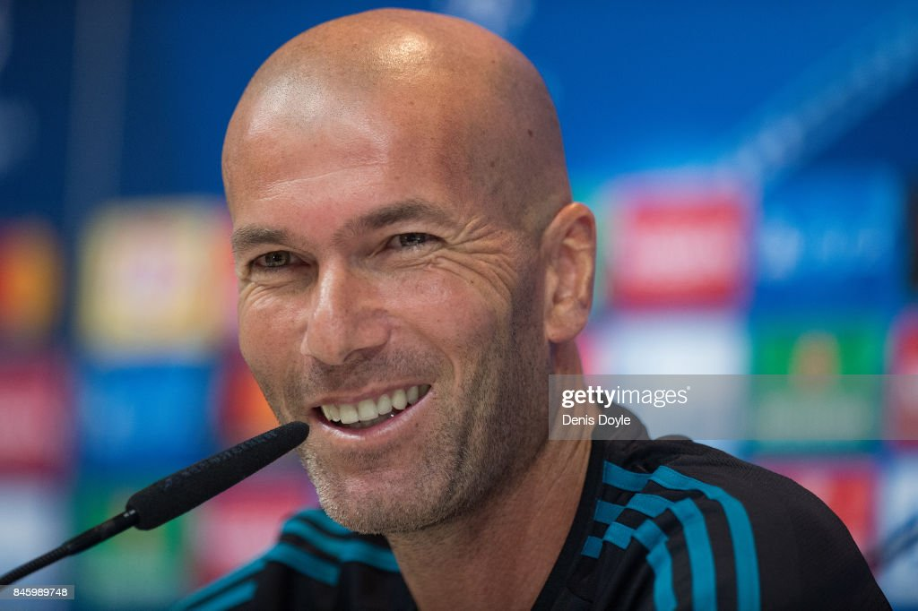 Real Madrid CF manager Zinedine Zidane smiles during the Real Madrid CF training session at Valdebebas training ground on September 12, 2017 in Madrid, Spain.