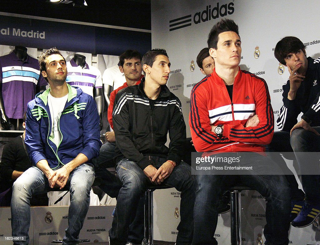 Real Madrid CF player of Real Madrid CF (L-R) <a gi-track='captionPersonalityLinkClicked' href=/galleries/search?phrase=Alvaro+Arbeloa&family=editorial&specificpeople=3941965 ng-click='$event.stopPropagation()'>Alvaro Arbeloa</a>, <a gi-track='captionPersonalityLinkClicked' href=/galleries/search?phrase=Angel+Di+Maria&family=editorial&specificpeople=4110691 ng-click='$event.stopPropagation()'>Angel Di Maria</a> and Jose Callejon attend the opening of the new 'Adidas' store at the Santiago Bernabeu stadium on February 21, 2013 in Madrid, Spain.