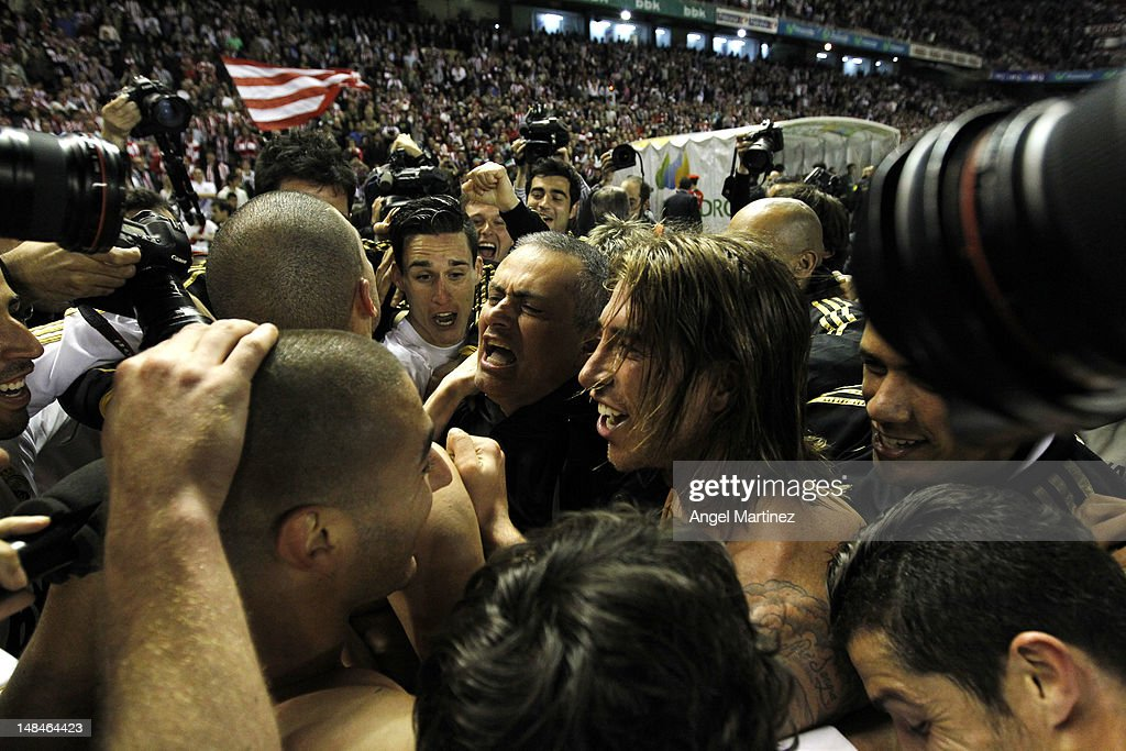 Real Madrid CF players celebrate with head coach Jose Mourinho (C) after beating Athletic Club 3-0 to win the La Liga Championships during the La Liga match between Athletic Club and Real Madrid CF at estadio San Mames on May 2, 2012 in Bilbao, Spain.