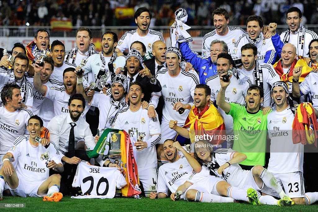Real Madrid CF players celebrate with the trophy after winning the Copa del Rey Final between Real Madrid and FC Barcelona at Estadio Mestalla on April 16, 2014 in Valencia, Spain.