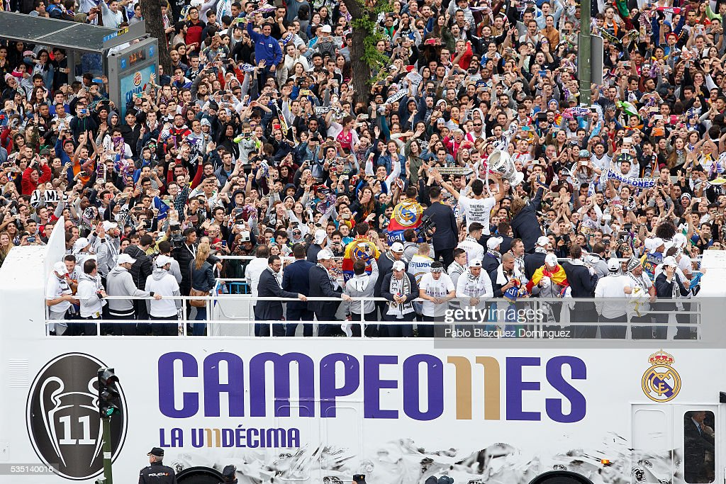 Real Madrid CF players celebrate with their fans at Cibeles Square after winning the Uefa Champions League Final match against Club Atletico de Madrid on May 29, 2016 in Madrid, Spain.