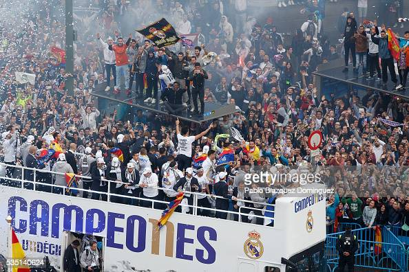 Real Madrid CF players celebrate with their fans at Cibeles Square after winning the Uefa Champions League Final match against Club Atletico de...