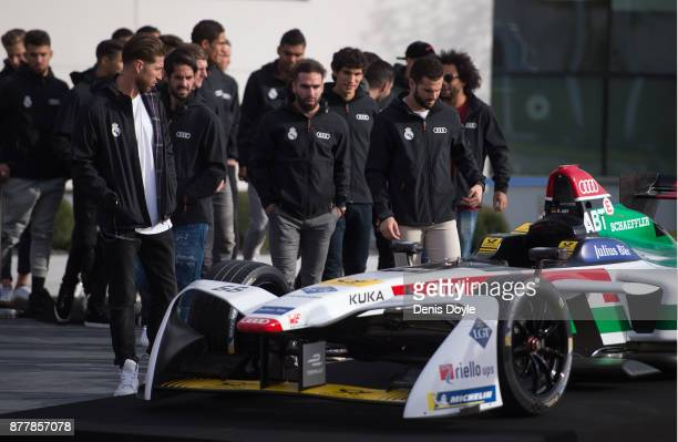 Real Madrid CF players look at the Audi e racing car during the presentation of their new Audi cars as part of an ongoing sponsorship deal with Real...