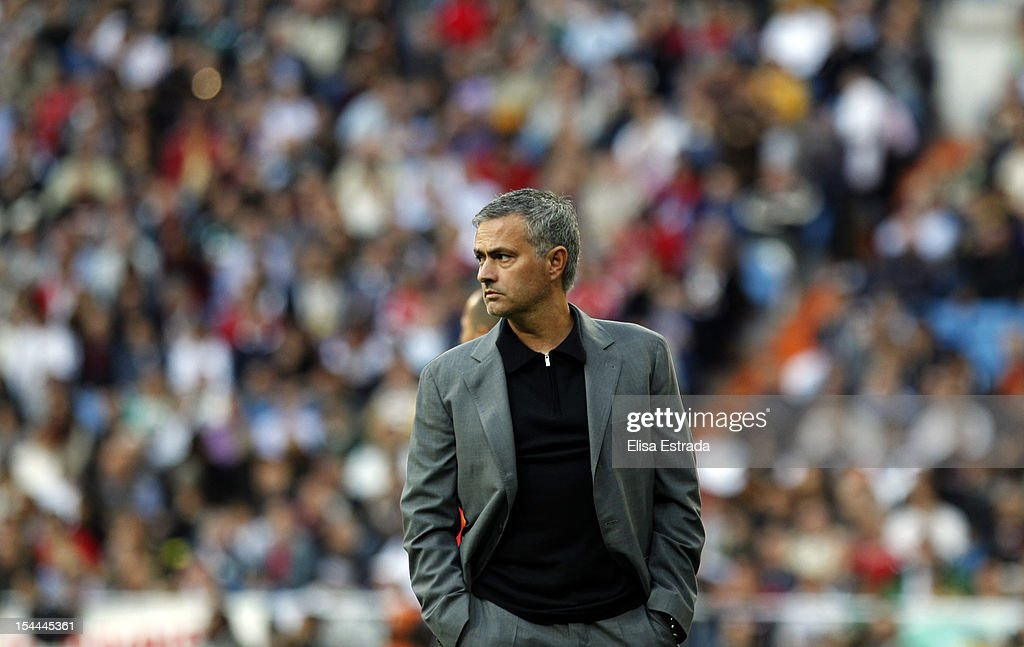 Real Madrid coach Jose Mourinho looks on during the La Liga match between Real Madrid and Celta de Vigo at Bernabeu on October 20, 2012 in Madrid, Spain.