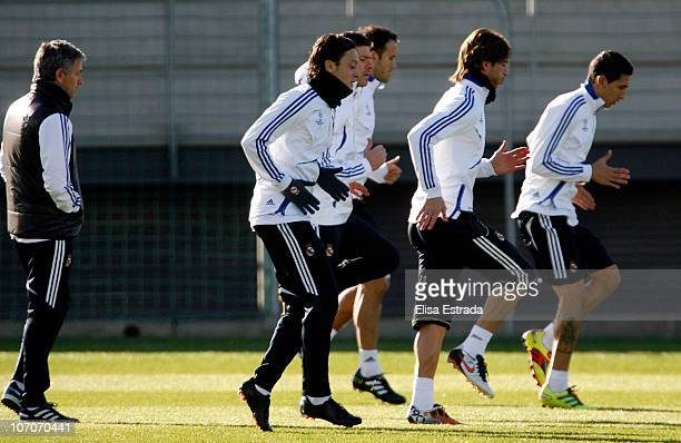 Real Madrid coach Jose Mourinho Mesut Ozil Sergio Ramos and Angel di Maria in action during a training session at Valdebebas training ground ahead of...