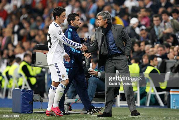 Real Madrid coach Jose Mourinho shakes hands with his player Mesut Ozil during the UEFA Champions League group G match between Real Madrid and AC...
