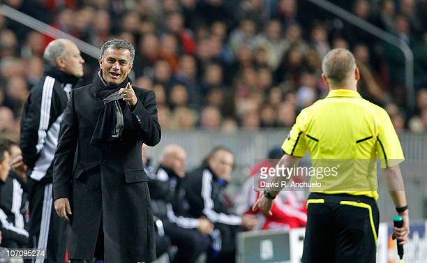 Real Madrid coach Jose Mourinho talks to referee's assistant during the UEFA Champions League Group G match between Ajax Amsterdam and Real Madrid at...