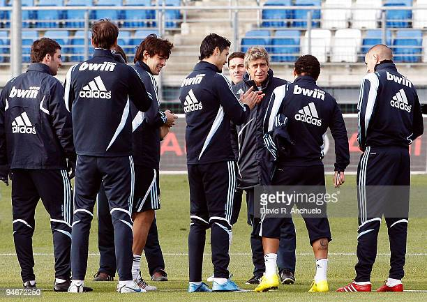 Real Madrid coach Manuel Pellegrini talks to his players during a training session at Valdebebas on December 17 2009 in Madrid Spain