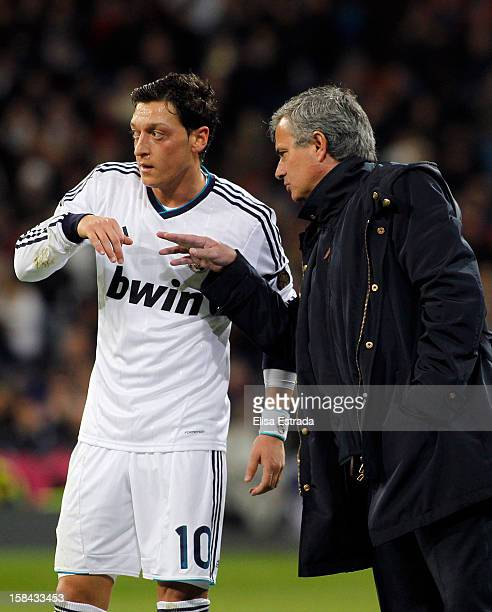 Real Madrid coch Jose Mourinho gives instructions to his player Mesut Ozil during the La Liga match between Real Madrid and RCD Espanyol at Santiago...