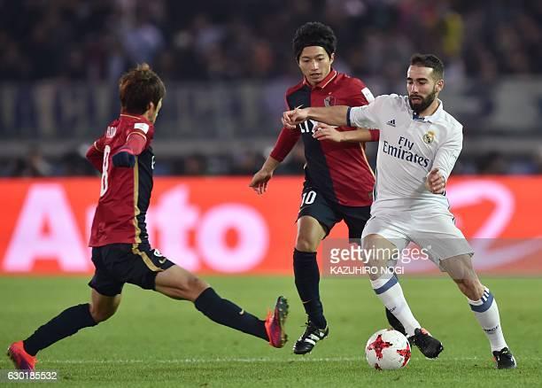 Real Madrid defender Daniel Carvajal fights for the ball with Kashima Antlers midfielder Shoma Doi and Kashima Antlers midfielder Gaku Shibasaki...