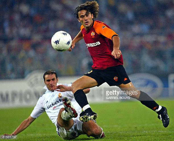 Real Madrid defender Ivan Helguera tries to tackle AS Roma forward Vincenzo Montella during the Champions' League Group C first round match AS...