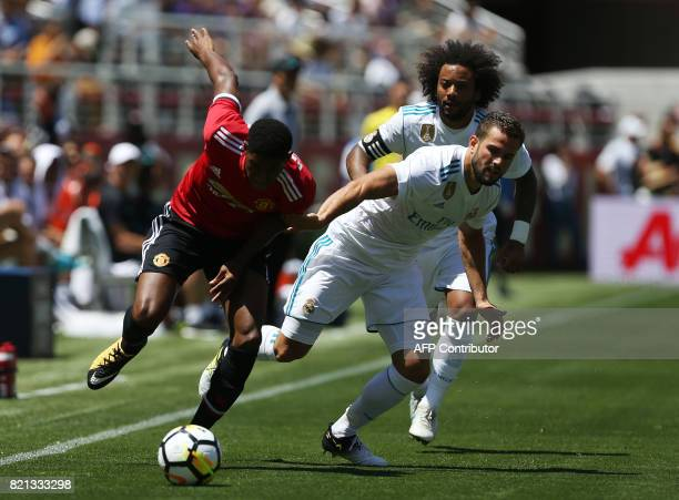 Real Madrid defender Jose Ignacio Fernandez Iglesias right and Real Madrid forward Marcus Rashford battle for the ball during the first half of the...