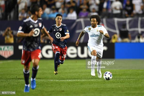 Real Madrid defender Marcelo controls the ball next to MLS AllStar Miguel Almiron in the second half during a soccer match between the MLS AllStars...