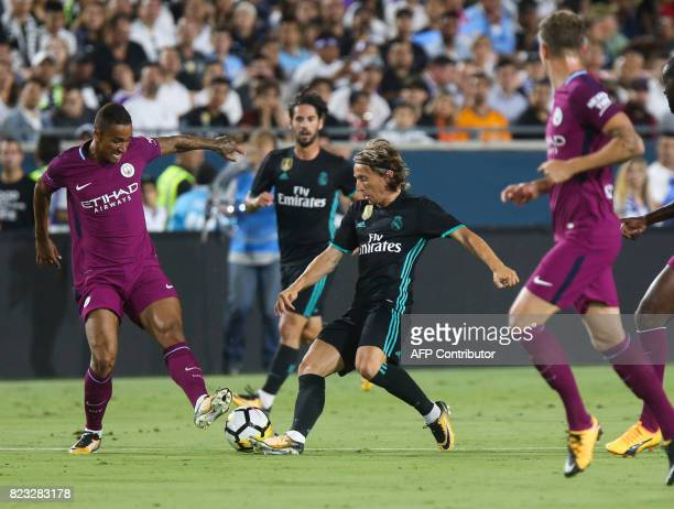 Real Madrid defender Modric vies the against Manchester City's Danilo during their International Champions Cup football match on July 26 2017 at the...
