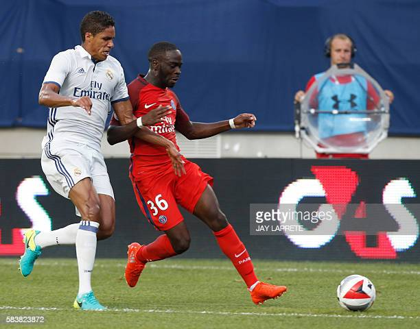 Real Madrid defender Raphael Varane tries to steal the ball from Paris SaintGermain midfielder Jonathan Ikone during an International Champions Cup...
