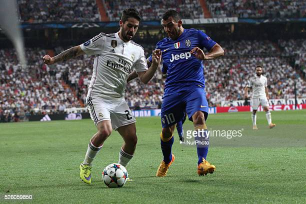 Real Madrid defender Raphael Varane vies with Juventus forward Carlos Tevez during the Uefa Champions League semi finals football match REAL MADRID...