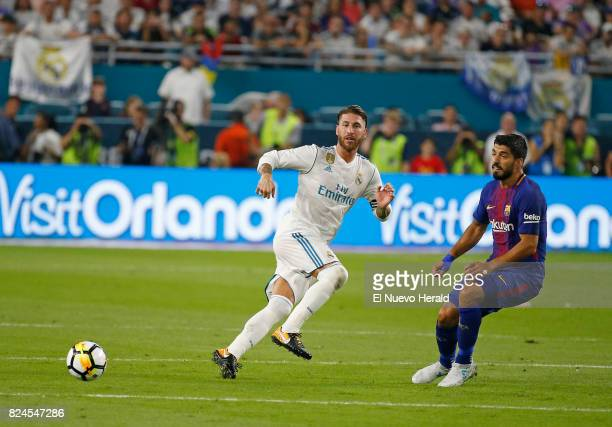 Real Madrid defender Sergio Ramos vies with Barcelona forward Luis Suarez during the first half of the ''El Clasico Miami'' BarcelonaReal Madrid...
