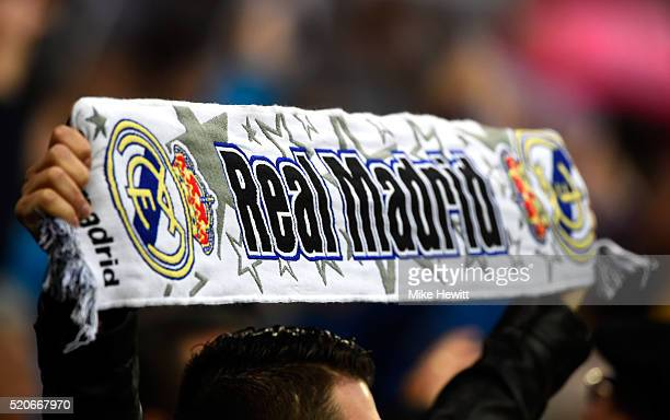 Real Madrid fan holds a scarf prior to the UEFA Champions League quarter final second leg match between Real Madrid CF and VfL Wolfsburg at Estadio...