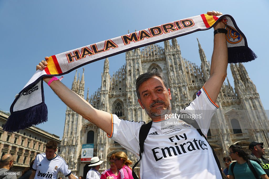 A Real Madrid fan poses at Piazza Duomo ahead of the UEFA Champions League Final match between Real Madrid and Club Atletico de Madrid at Stadio Giuseppe Meazza on May 28, 2016 in Milan, Italy.