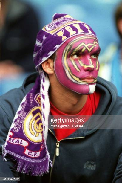 A Real Madrid fan with the club badge painted on his face