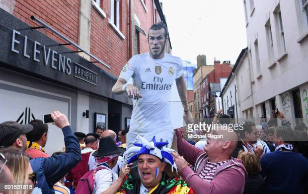 Real Madrid fans carry a Gareth Bale figure as they enjoy the city centre atmosphere prior to the UEFA Champions League Final between Juventus and...