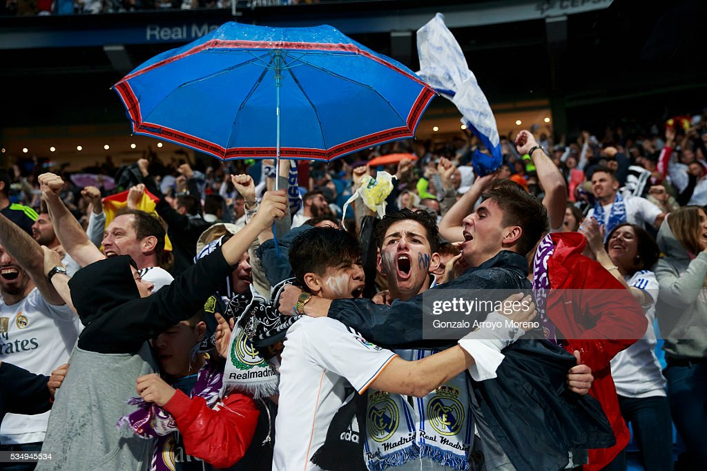 Real Madrid fans celebrate Sergio Ramo's opening goal at Estadio Santiago Bernabeu during the UEFA Champions League Final match between Real Madrid CF and Club Atletico de Madrid on May 28, 2016 in Madrid, Spain. More than 85,000 Santiago Bernabeu seats have been sold out to watch on giant screens the UEFA Champions League Final which is being held in Milan.