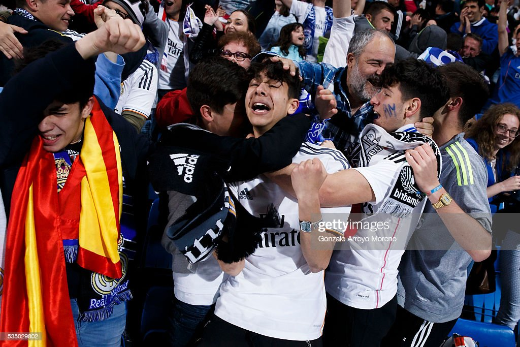 Real Madrid fans celebrate their victory at Estadio Santiago Bernabeu at the end of the UEFA Champions League Final match between Real Madrid CF and Club Atletico de Madrid on May 28, 2016 in Madrid, Spain. More than 85,000 Santiago Bernabeu seats have been sold out to watch on giant screens the UEFA Champions League Final which is being held in Milan.