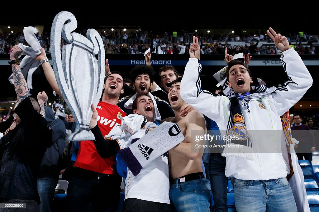 Real Madrid fans celebrate with a card-boar made Trophy their victory at Estadio Santiago Bernabeu after the UEFA Champions League Final match between Real Madrid CF and Club Atletico de Madrid on May 28, 2016 in Madrid, Spain. More than 85,000 Santiago Bernabeu seats have been sold out to watch on giant screens the UEFA Champions League Final which is being held in Milan.