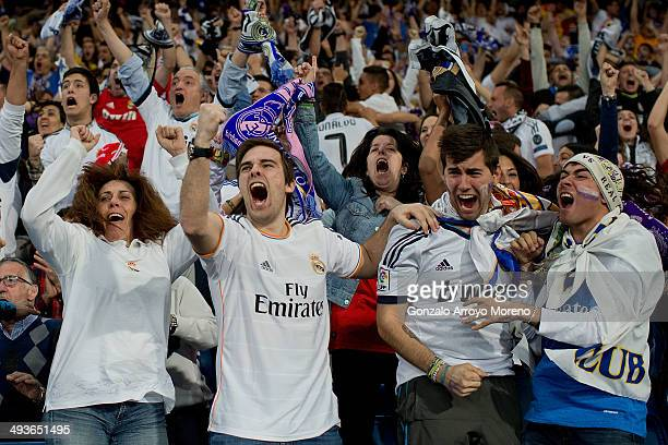 Real Madrid fans celebrates Real Madrid player Marcelo«s second goal at Santiago Bernabeu Stadium during the UEFA Champions League Final match...
