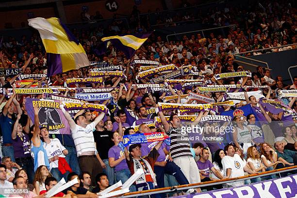 Real Madrid fans cheer for their team during the ACB Semifinal Game 2 match between Real Madrid and Tau Ceramica on June 4 2009 in Madrid Spain