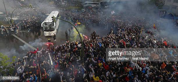 Real Madrid fans cheer the arrival of the players bus prior to the UEFA Champions League quarter final second leg match between Real Madrid and VfL...