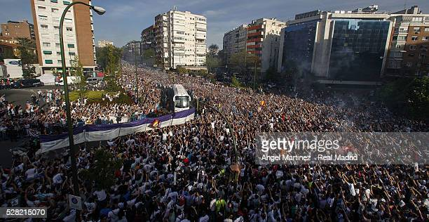 Real Madrid fans cheer the arrival of the players bus prior to the UEFA Champions League Semi Final second leg match between Real Madrid and...