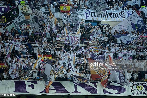 Real Madrid fans cheer theri team at Estadio Santiago Bernabeu grandstands prior to start during the UEFA Champions League round of 16 second leg...
