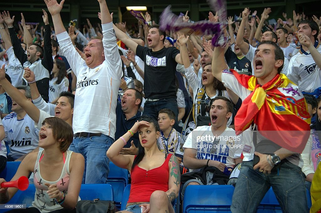 Real Madrid Fans Gesture And Shout As They Watch On A Big