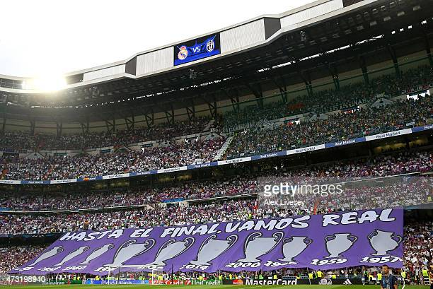 Real Madrid fans hold up banners prior to kickoff during the UEFA Champions League Semi Final second leg match between Real Madrid and Juventus at...