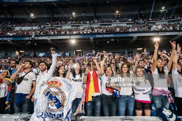 Real Madrid fans in Santiago Bernabeu stadium during the celebration of the 12th Champions League title